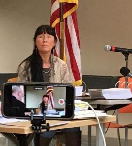 Donna testifying in 2019